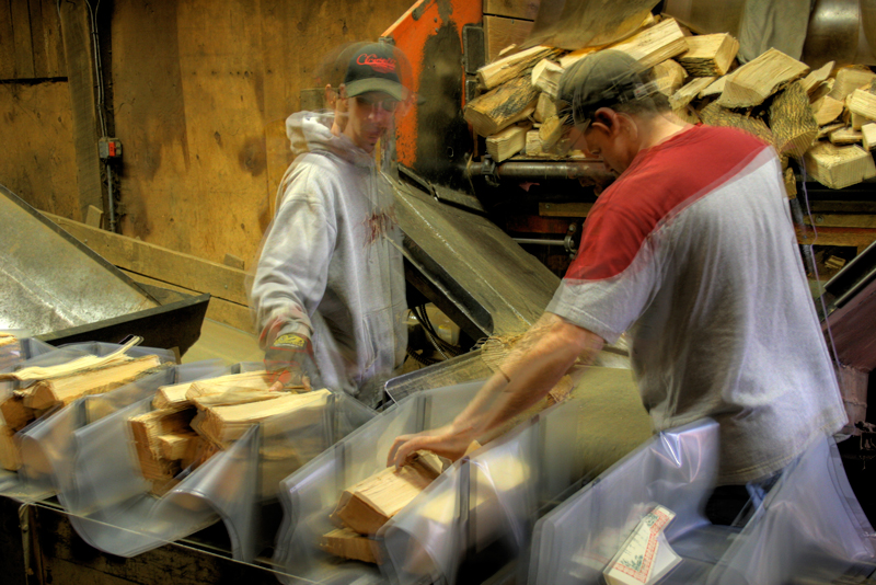 Packing firewood packages from West End Firewood